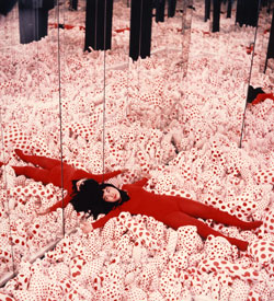 Kusama with 'Infinity Mirror Room — Phalli's Field', Castellane Gallery, New York, 1965
